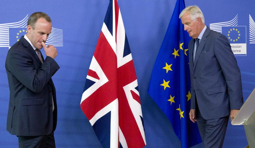 Britain's Secretary of State for Exiting the European Union Dominic Raab, left, and EU chief Brexit negotiator Michel Barnier prepare to shake hands after a media conference at EU headquarters in Brussels on Friday, Aug. 31, 2018. (AP Photo/Virginia Mayo)