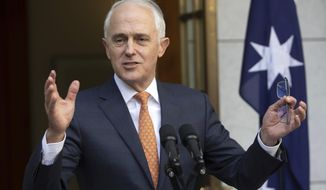 FILE - In this Friday, Aug. 24, 2018, file photo, outgoing Australian Prime Minister Malcolm Turnbull speaks during his final press conference before leaving Parliament in Canberra. Turnbull has resigned from Parliament, triggering a by-election that could bring down the unpopular conservative government.  (AP Photo/Andrew Taylor, File)