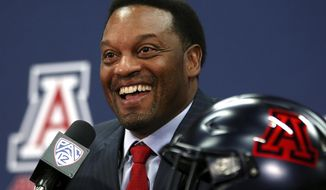 FILE - In this Jan. 16, 2018, file photo, new University of Arizona Wildcats head football coach Kevin Sumlin speaks during his introductory press conference in Tucson, Ariz. The Kevin Sumlin Era begins at Arizona on Saturday. The Wildcats should be tested right away with BYU coming to town. (Mike Christy/Arizona Daily Star via AP, File)