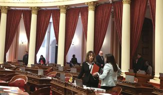 Senate Republican Leader Patricia Bates, of Laguna Niguel, left, talks with Sen. Janet Nguyen, R-Fountain, as the Senate empties for a break Friday, Aug. 31, 2018, in Sacramento, Calif. Friday is the final day for California lawmakers to consider gills before they adjourn until after the November elections. (AP Photo/Rich Pedroncelli)
