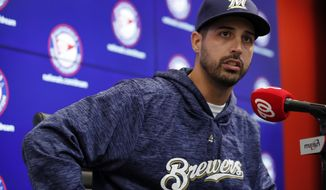 Milwaukee Brewers pitcher Gio Gonzalez speaks during a media availability after he was recently acquired in a trade with the Washington Nationals at Nationals Park, Friday, Aug. 31, 2018, in Washington. (AP Photo/Alex Brandon)