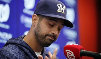Milwaukee Brewers pitcher Gio Gonzalez pauses while speaking during a media availability after he was recently acquired in a trade with the Washington Nationals at Nationals Park, Friday, Aug. 31, 2018, in Washington. (AP Photo/Alex Brandon)