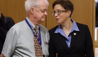 FILE - In this Feb. 13, 2015, file photo, Oregon Senate President Peter Courtney, left, and Speaker of the House Tina Kotek confer at the Capitol in Salem, Ore. Oregon's Legislature is battling an effort by the state's labor commissioner, Brad Avakian, to investigate sexual harassment in the state Capitol, saying he lacks jurisdiction and would violate privacy of people who came forward under assurances their identities wouldn't be disclosed. (AP Photo/Timothy J. Gonzalez, File)