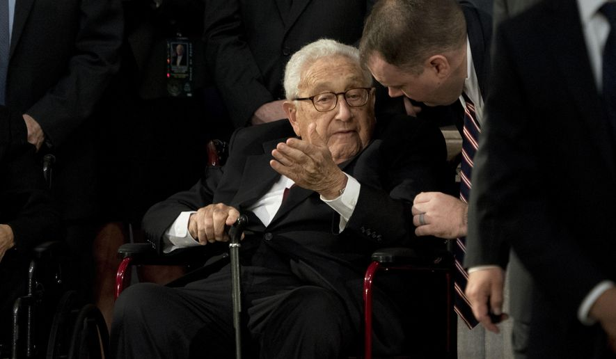 Former Secretary of State Henry Kissinger arrives in the Rotunda before the casket of Sen. John McCain, R-Ariz., lies in state at the U.S. Capitol, Friday, Aug. 31, 2018, in Washington. (AP Photo/Andrew Harnik, Pool)