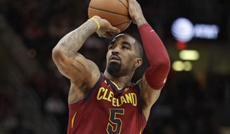 FILE - In this Jan. 28, 2018, file photo, Cleveland Cavaliers' JR Smith shoots against the Detroit Pistons in the first half of an NBA basketball game, in Cleveland.  J.R. Smith has been accused of breaking the cellphone of a fan who tried to videotape him in the middle of the night on a New York City street. Police say the Cavaliers guard turned himself in Friday, Aug. 31, 2018, to face a misdemeanor criminal mischief charge. The NBA champion was given a summons to appear in court at a later date and released. (AP Photo/Tony Dejak, File)