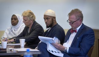 In this Aug. 29, 2018, file photo, Jany Leveille, from left, with her attorney Kelly Golightley, and Siraj Ibn Wahhaj with attorney Tom Clark listen to the prosecutor during a hearing on a motion to dismiss in the Taos County Courthouse. Federal prosecutors say the FBI has arrested five former residents, including Leveille and Wahhaj, of a ramshackle compound in northern New Mexico on firearms and conspiracy charges as local prosecutors dropped charges in the death of a 3-year-old boy at the property. Taos County District Attorney Donald Gallegos said Friday, Aug. 31, his office will now seek grand jury indictments involving the death. (Eddie Moore/The Albuquerque Journal via AP, Pool, File)
