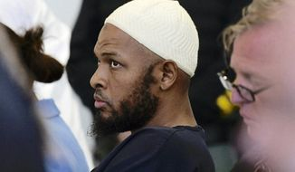 FILE - In this Aug. 13, 2018, file photo defendant Siraj Ibn Wahhaj sits in court in Taos, N.M., during a detention hearing. Federal prosecutors say the FBI has arrested five former residents, including Wahhaj, of a ramshackle compound in northern New Mexico on firearms and conspiracy charges as local prosecutors dropped charges in the death of a 3-year-old boy at the property. Taos County District Attorney Donald Gallegos said Friday, Aug. 31, his office will now seek grand jury indictments involving the death. (Roberto E. Rosales/The Albuquerque Journal via AP, Pool, File)
