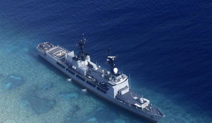 In this photo provided by the Armed Forces of the Philippines, the Philippine Navy ship BRP Gregorio del Pilar is seen after it ran aground during a routine patrol Wednesday, Aug. 29, 2018, in the vicinity of Half Moon Shoal, which is called Hasa Hasa in the Philippines, off the disputed Spratlys Group of islands in the South China Sea, adding that its crew was unhurt, the military said. Two officials say Friday, Aug. 31, 2018, the Philippines has notified China about a Philippine navy frigate that ran aground in the South China Sea to avoid any misunderstanding because the incident happened near a hotly disputed region. The barren shoal is on the eastern edge of the disputed Spratly archipelago. (Armed Forces of the Philippines via AP)