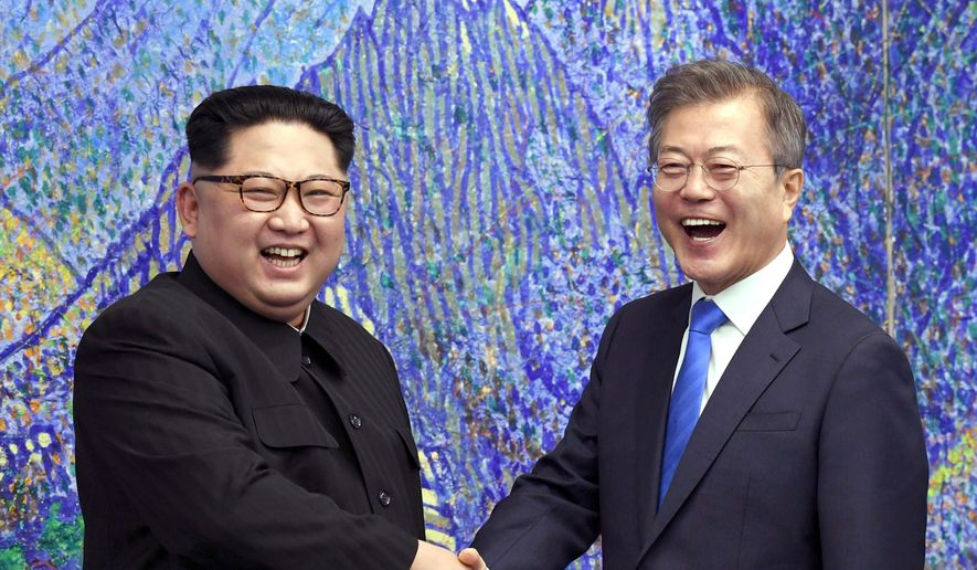In this April 27, 2018, file photo, North Korean leader Kim Jong-un, left, poses with South Korean President Moon Jae-in for a photo inside the Peace House at the border village of Panmunjom in Demilitarized Zone, South Korea. Moon will send an envoy to North Korea next week for talks on a nuclear standoff and to set up a summit planned for next month, his office said Friday, Aug. 31, 2018. (Korea Summit Press Pool via AP. File)