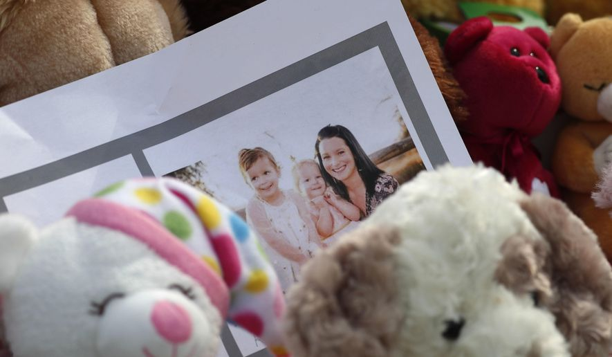 FILE - In this Thursday, Aug. 16, 2018 file photo, a photograph sits amid mementos outside the home where a pregnant woman, Shanann Watts, and her two daughters, Bella and Celeste, lived in Frederick, Colo. Police say Christopher Watts killed his family inside the family's suburban Denver home then dumped their bodies on his former employer's property. (AP Photo/David Zalubowski)