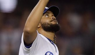 Los Angeles Dodgers relief pitcher Kenley Jansen gestures after the Dodgers defeated the Arizona Diamondbacks 3-1 in a baseball game Friday, Aug. 31, 2018, in Los Angeles. (AP Photo/Mark J. Terrill)
