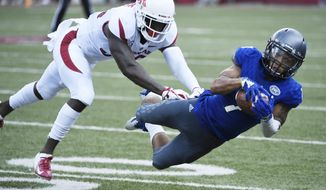 Arkansas defender D'Vone McClure puts the pressure on Eastern Illinois receiver Aaron Gooch as he makes a catch in the first half of an NCAA college football game Saturday, Sept. 1, 2018, in Fayetteville, Ark. (AP Photo/Michael Woods)
