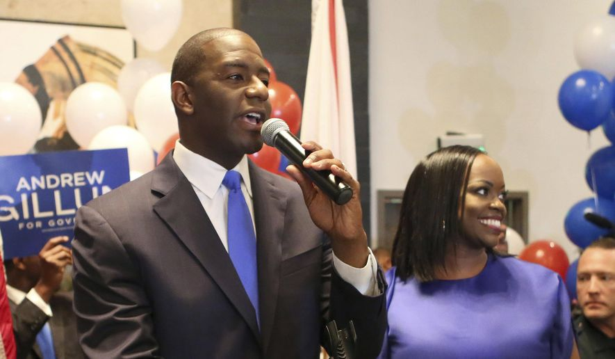 FILE - In this Aug. 28, 2018, file photo, Andrew Gillum and his wife, R. Jai Gillum, address supporters in Tallahassee, Fla. Gillum defeated former U.S. Rep. Gwen Graham and four other candidates. Republicans are taking aim at his tenure as mayor of Tallahassee, including an ongoing FBI investigation into City Hall, that Gillum claims he is not a target. Gillum will face GOP gubernatorial nominee Congressman Ron DeSantis. (AP Photo/Steve Cannon, File)