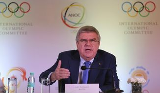 FILE - In this Thursday April 19, 2018 file photo, International Olympic Committee (IOC) President Thomas Bach addresses a press conference in New Delhi, India. Bach said in Jakarta, Saturday, Sept. 1, 2018, that he isn't certain if, or when, esports might be incorporated into the Olympic Games. (AP Photo/Altaf Qadri,File)