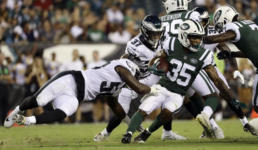 New York Jets' Charcandrick West (35) is tackled by Philadelphia Eagles' Jordan Hicks (58) during the first half of a preseason NFL football game Thursday, Aug. 30, 2018, in Philadelphia. (AP Photo/Michael Perez)