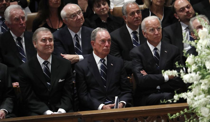 Front from left, former Defense Secretary William Cohen, former New York Mayor Michael Bloomberg and former Vice President Joe Biden listen during a memorial service for Sen. John McCain, R-Ariz., at Washington National Cathedral in Washington, Saturday, Sept. 1, 2018. McCain died Aug. 25, from brain cancer at age 81. Back row, second from right is former Texas Senator Phil Gramm and third from left is former Wisconsin Sen. Russ Feingold. (AP Photo/Pablo Martinez Monsivais)