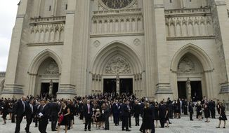 People leave the Washington National Cathedral in Washington, Saturday, Sept. 1, 2018, following a memorial service for Sen. John McCain, R-Ariz. McCain died Aug. 25 from brain cancer at age 81. (AP Photo/Susan Walsh)