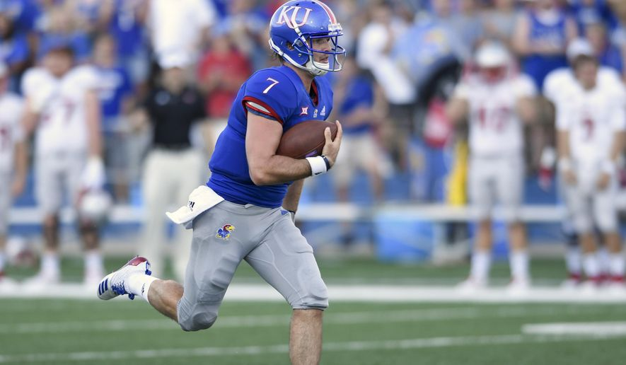 Kansas quarterback Peyton Bender (7) runs for a first down against Nicholls State during the first quarter of an NCAA college football game in Lawrence, Kan., Saturday, Sept. 1, 2018. (AP Photo/Reed Hoffmann) ** FILE **