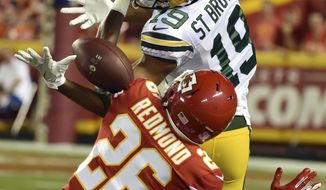 Kansas City Chiefs cornerback Will Redmond (26) breaks up a pass intended for Green Bay Packers wide receiver Equanimeous St. Brown (19) during the first half of an NFL preseason football game in Kansas City, Mo., Thursday, Aug. 30, 2018. (AP Photo/Ed Zurga)