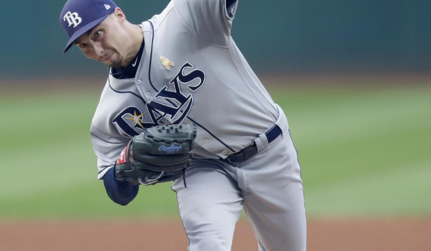 Tampa Bay Rays starting pitcher Blake Snell delivers in the first inning of a baseball game against the Cleveland Indians, Saturday, Sept. 1, 2018, in Cleveland. (AP Photo/Tony Dejak)