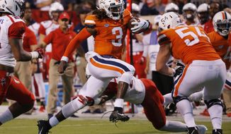 Virginia quarterback Bryce Perkins (3) runs for a touchdown against Richmond in the first half of an NCAA college football game, Saturday, Sept. 1, 2018, in Charlottesville, Va. (Joe Mahoney/Richmond Times-Dispatch via AP)