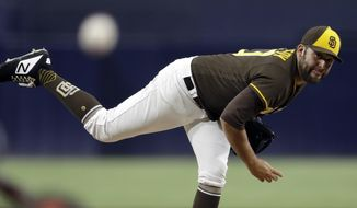 San Diego Padres starting pitcher Brett Kennedy works against a Colorado Rockies batter during the first inning of a baseball game Friday, Aug. 31, 2018, in San Diego. (AP Photo/Gregory Bull)