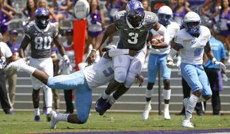 TCU quarterback Shawn Robinson (3) lunges across the goal line for a touchdown as Southern University safety Cordell Caldwell tries to stop him during the first half of an NCAA college football game Saturday, Sept. 1, 2018, in Fort Worth, Texas. (AP Photo/Ron Jenkins)