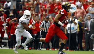Maryland wide receiver Jeshaun Jones, right, runs past Texas defensive back Brandon Jones for a touchdown in the first half of an NCAA college football game, Saturday, Sept. 1, 2018, in Landover, Md. (AP Photo/Patrick Semansky)  **FILE**