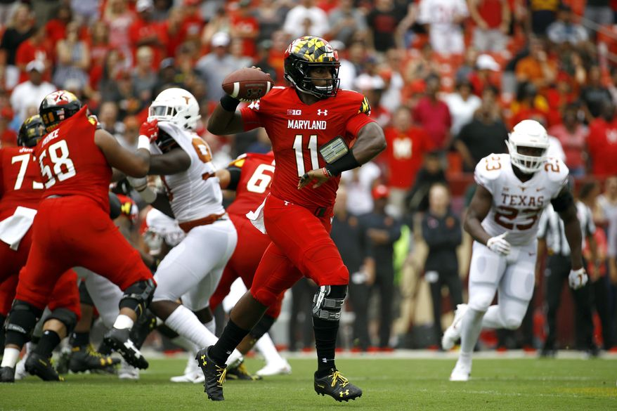 Maryland quarterback Kasim Hill (11) throws to a receiver in the first half of an NCAA college football game against Texas, Saturday, Sept. 1, 2018, in Landover, Md. (AP Photo/Patrick Semansky) ** FILE **
