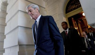 """FILE - In this June 21, 2017, file photo, former FBI Director Robert Mueller, the special counsel probing Russian interference in the 2016 election, departs Capitol Hill following a closed door meeting in Washington. Lawyers for George Papadopoulos are seeking probation, saying the foreign policy adviser misled agents during a January 2017 interview not to harm an investigation but rather to """"save his professional aspirations and preserve a perhaps misguided loyalty to his master."""" Papadopoulos is a pivotal figure in special counsel Mueller's investigation as the first Trump campaign aide to plead guilty and cooperate with prosecutors. (AP Photo/Andrew Harnik, File)"""