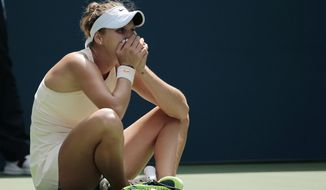 Marketa Vondrousova, of the Czech Republic, reacts after defeating Kiki Bertens, of the Netherlands, during the third round of the U.S. Open tennis tournament, Saturday, Sept. 1, 2018, in New York. (AP Photo/Andres Kudacki)