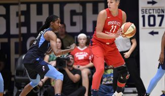 Washington Mystics forward Elena Delle Donne (11) dribbles the ball against Atlanta Dream forward Jessica Breland (51) during the first half of Game 4 of a WNBA basketball playoffs semifinal Sunday, Sept. 2, 2018, in Washington. (AP Photo/Nick Wass)