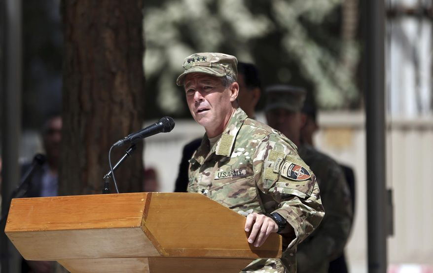 U.S. Army Gen. Austin Scott Miller speaks during the change of command ceremony at Resolute Support headquarters in Kabul, Afghanistan, Sunday, Sept. 2, 2018. Miller assumed command of the 41-nation NATO mission in Afghanistan following a handover ceremony. (AP Photo/Massoud Hossaini)