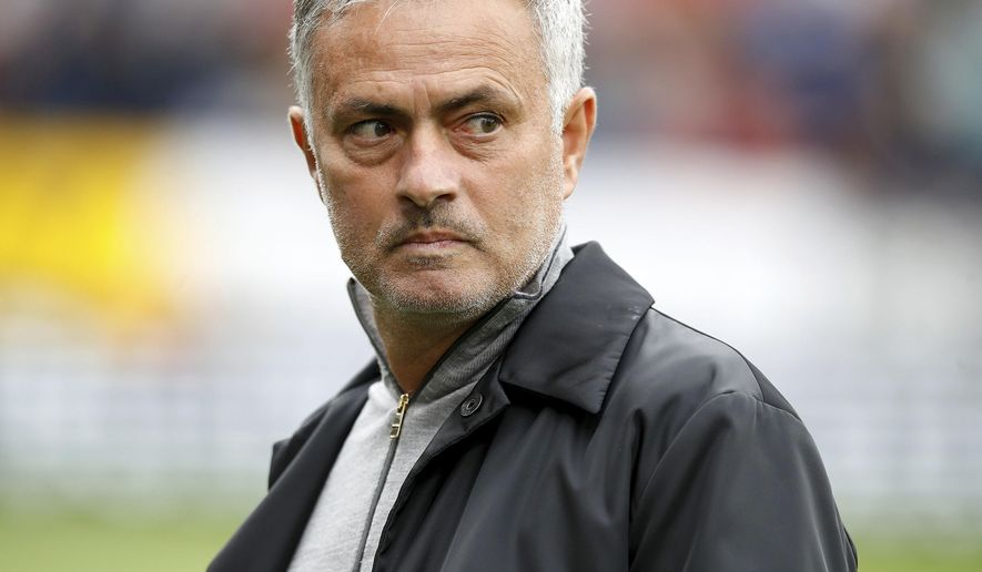 Manchester United manager Jose Mourinho walks on the pitch before a Premier League soccer match between Burnley and Manchester City, at Turf Moor, Burnley, Britain, Sunday, Sept. 2, 2018. (Martin Ricket/PA via AP)