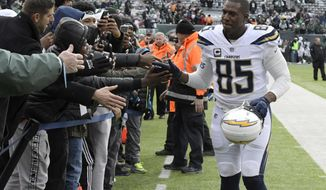 FILE - In this Dec. 24, 2017, file photo, Los Angeles Chargers tight end Antonio Gates (85) greets fans before an NFL football game against the New York Jets in East Rutherford, N.J. Gates has re-signed with the Los Angeles Chargers for his 16th season. The Chargers announced a one-year deal Sunday, Sept. 2, 2018, with Gates, the leading receiver in franchise history. (AP Photo/Bill Kostroun, File)