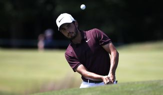 Abraham Ancer chips onto the second green during the third round of the Dell Technologies Championship golf tournament at TPC Boston in Norton, Mass., Sunday, Sept. 2, 2018. (AP Photo/Michael Dwyer)