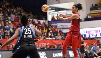 Washington Mystics guard Kristi Toliver, right, passes the ball against Atlanta Dream forward Monique Billings (25) during the second half of Game 4 of a WNBA basketball playoffs semifinal Sunday, Sept. 2, 2018, in Washington. (AP Photo/Nick Wass) ** FILE **