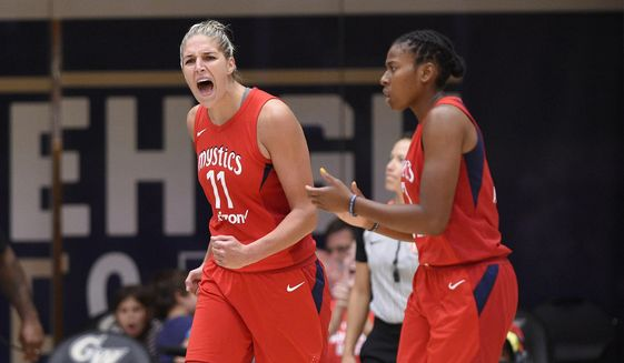 Washington Mystics forward Elena Delle Donne (11) reacts next to Ariel Atkins, right, during the second half of Game 4 of a WNBA basketball playoffs semifinal against the Atlanta Dream, Sunday, Sept. 2, 2018, in Washington. (AP Photo/Nick Wass) ** FILE **