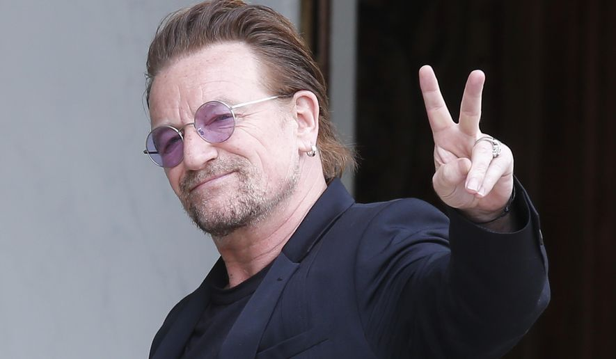 FILE - In this Monday, July 24, 2017 file photo, U2 singer Bono makes a peace sign as he arrives for a meeting at the Elysee Palace, in Paris, France. (AP Photo/Michel Euler, file)