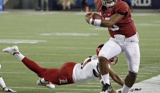 Alabama quarterback Tua Tagovailoa, right, is forced out of bounds by Louisville safety Dee Smith after a short gain during the first half of an NCAA college football game Saturday, Sept. 1, 2018, in Orlando, Fla. (AP Photo/John Raoux)