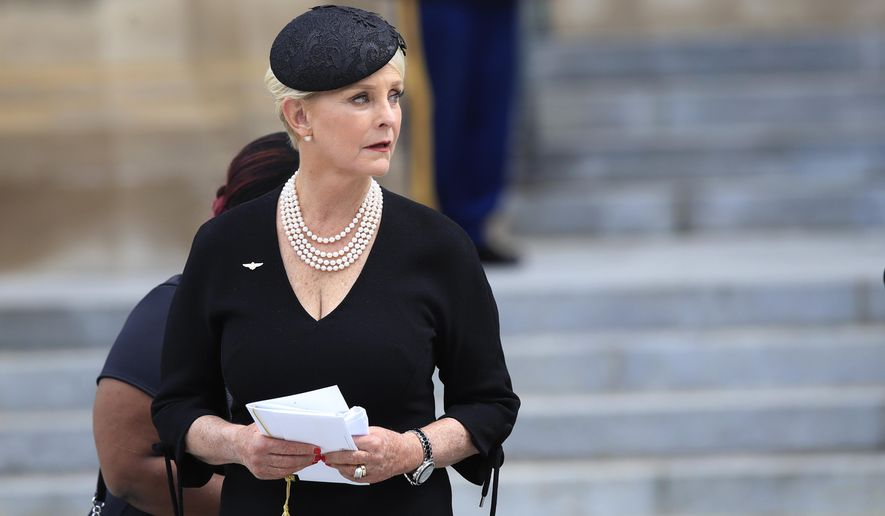 Cindy McCain, glances back towards the hearse carrying her husband's casket, before leaving the cathedral following a memorial service for her husband Sen. John McCain, R-Ariz., at the Washington National Cathedral in Washington, Saturday, Sept. 1, 2018. (AP Photo/Manuel Balce Ceneta) ** FILE **