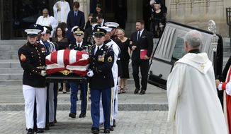 The casket of Sen. John McCain, R-Ariz., followed by family members, is carried out of Washington National Cathedral in Washington , Saturday, Sept. 1, 2018, following a memorial service. McCain died Aug. 25 from brain cancer at age 81. (AP Photo/Susan Walsh)