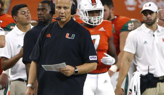 Miami coach Mark Richt watches from the sideline during the second half of the team's NCAA college football game against LSU on Sunday, Sept. 2, 2018, in Arlington, Texas. (AP Photo/Ron Jenkins)