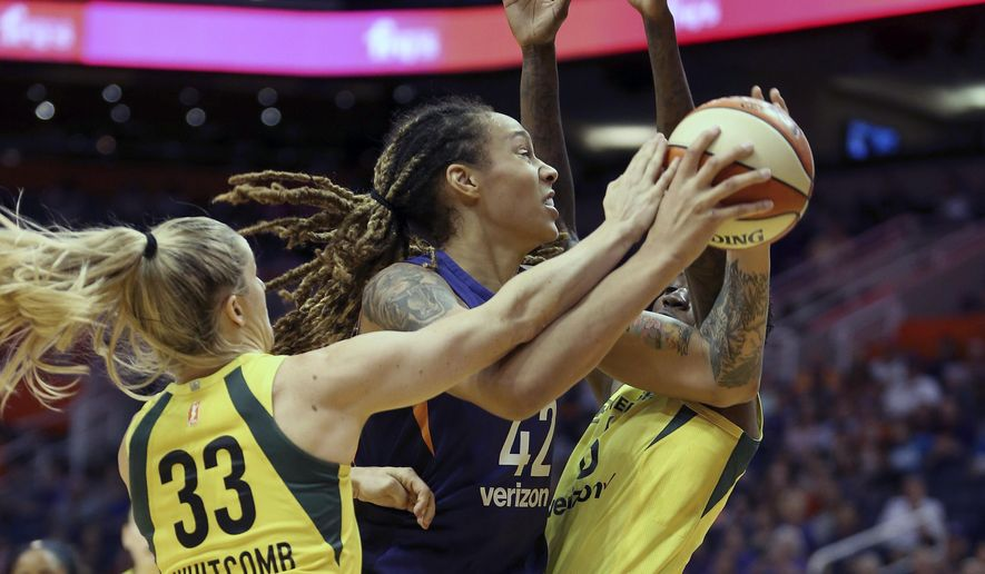 Phoenix Mercury center Brittney Griner (42) is guarded by Seattle Storm's Sami Whitcomb (33) and Natasha Howard as she tries to drive to the basket during the first half of Game 4 of a WNBA basketball semifinals playoff game, Sunday, Sept. 2, 2018, in Phoenix. (AP Photo/Ralph Freso)