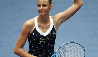 Karolina Pliskova, of the Czech Republic, waves to fans after defeating Ashleigh Barty, of Australia, in the fourth round of the U.S. Open tennis tournament, Sunday, Sept. 2, 2018, in New York. (AP Photo/Andres Kudacki)