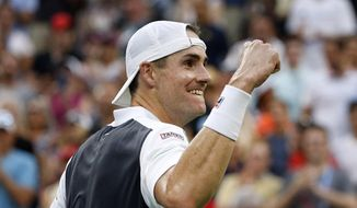 John Isner, of the United States, celebrates after defeating Milos Raonic, of Canada, during the fourth round of the U.S. Open tennis tournament, Sunday, Sept. 2, 2018, in New York. (AP Photo/Jason DeCrow)