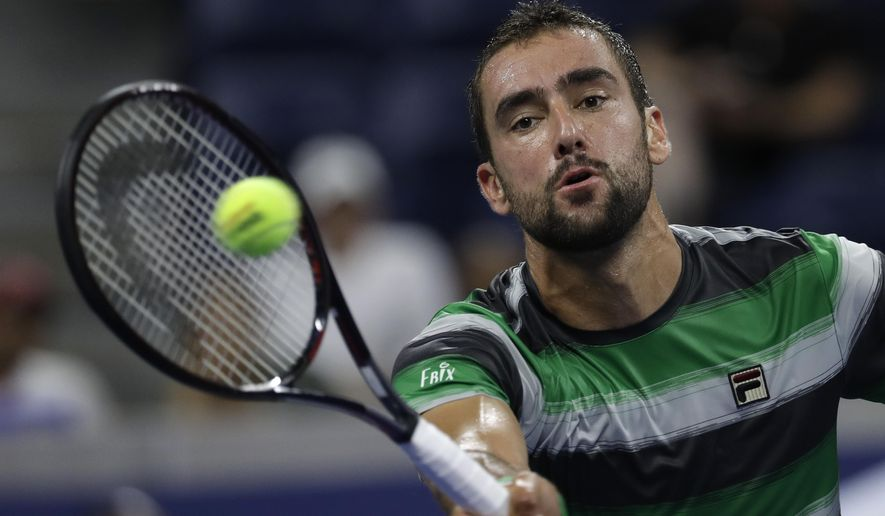 Marin Cilic, of Croatia, returns a shot against Alex de Minaur, of Australia, in a third-round tennis at the U.S. Open tennis championship, Saturday, Sept. 1, 2018, in New York. (AP Photo/Mark Lennihan)
