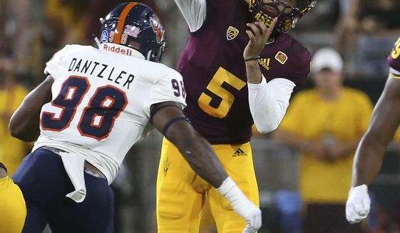 Arizona State quarterback Manny Wilkins (5) throws a pass as he is pressured by UTSA defensive end Lorenzo Dantzler during the second half of an NCAA college football game, Saturday, Sept. 1, 2018, in Tempe, Ariz. (AP Photo/Ralph Freso)