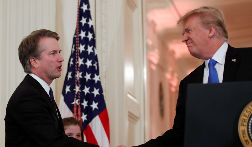 President Trump shares a hearty handshake with Judge Brett M. Kavanaugh, his Supreme Court nominee, in the White House on July 9, 2018. (Associated Press) ** FILE **