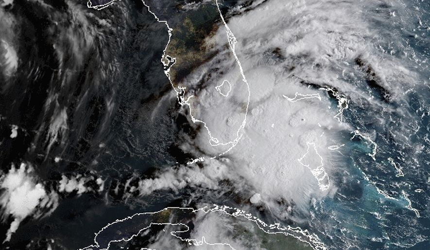 In this image released by NOAA's GOES-16 on Monday, Sept. 3, 2018, Tropical Storm Gordon appears south of Florida. The storm is expected to cross from southwest Florida into the Gulf Coast later Monday afternoon. (NOAA via AP)